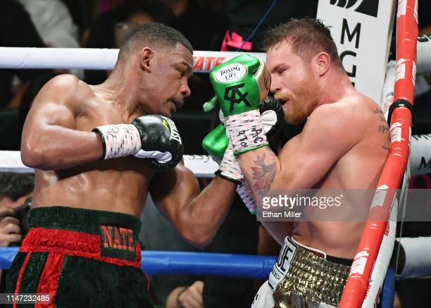 Daniel Jacobs hits Canelo Alvarez in the 10th round of their middleweight unification fight at T-Mobile Arena on May 4, 2019 in Las Vegas, Nevada....