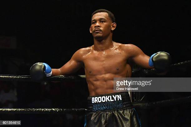 Daniel Jacobs looks on while after knocking down Sergio Mora during the WBA Middleweight Championship on September 9, 2016 in Reading, Pennsylvania.