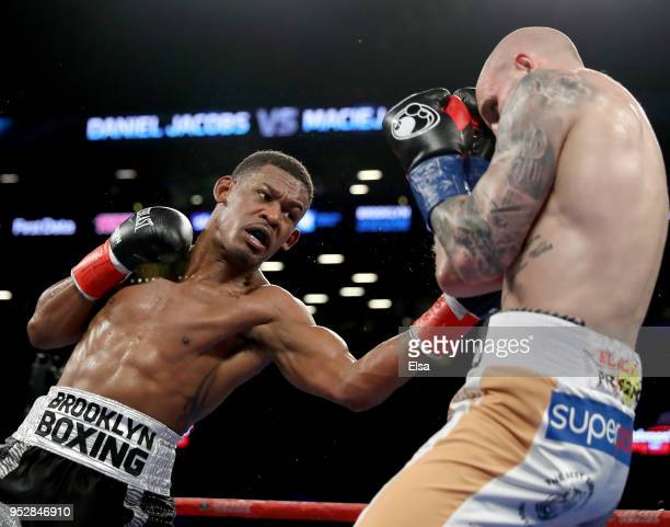 Daniel Jacobs of the USA and Maciej Sulecki of Poland exchange punches during their WBA World Middleweight Title bout at Barclays Center on April 28,...
