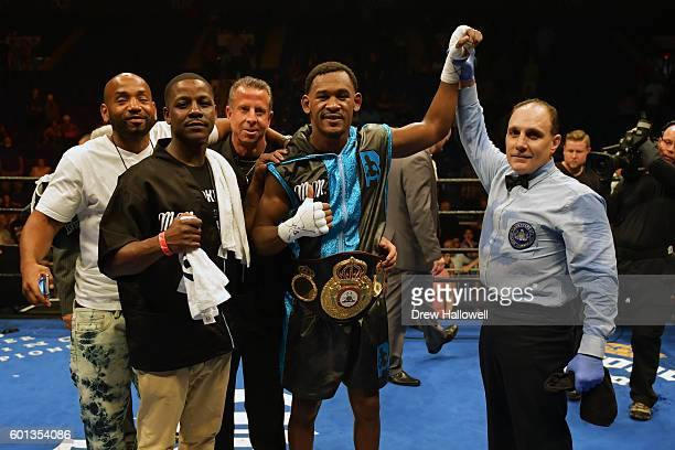 Daniel Jacobs poses for a photograph with his team after beating Sergio Mora with a TKO in the seventh round for the WBA Middleweight Championship on...