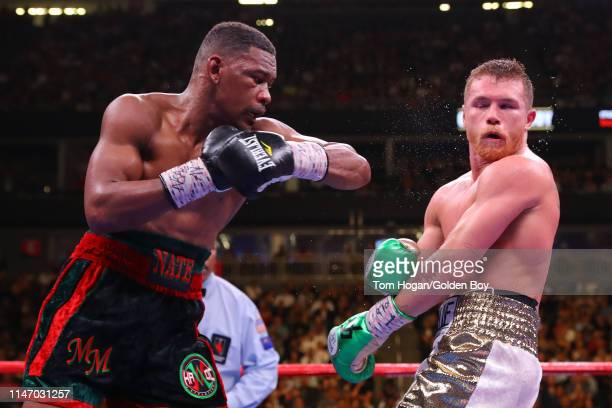 Daniel Jacobs punches Canelo Alvarez during their middleweight unification fight at T-Mobile Arena on May 04, 2019 in Las Vegas, Nevada.