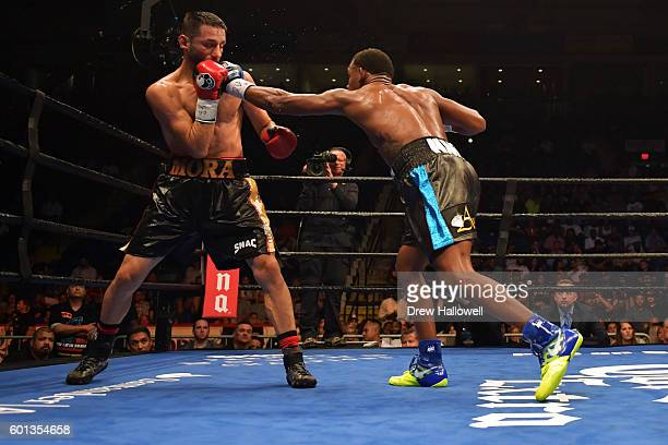 Daniel Jacobs punches Sergio Mora during the WBA Middleweight Championship on September 9, 2016 in Reading, Pennsylvania.