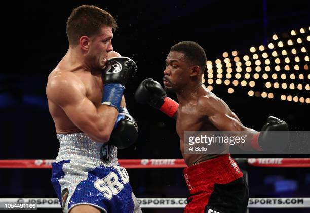 Daniel Jacobs punches Sergiy Derevyanchenko during their IBF middleweight title fight at Madison Square Garden on October 27, 2018 in New York City.