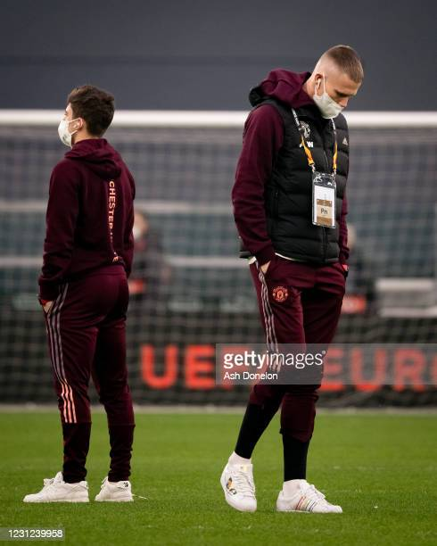 Daniel James and Scott McTominay of Manchester United look on prior to the UEFA Europa League Round of 32 match between Real Sociedad and Manchester...