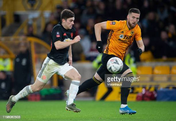 Daniel James of Manchester United and Matt Doherty of Wolverhampton Wanderers during the FA Cup Third Round match between Wolverhampton Wanderers and...