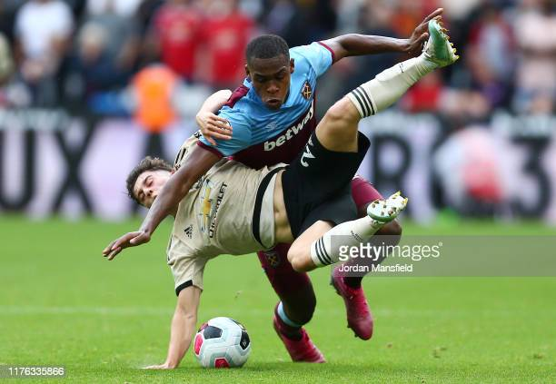 Daniel James of Manchester United battles for possession with Issa Diop of West Ham United during the Premier League match between West Ham United...