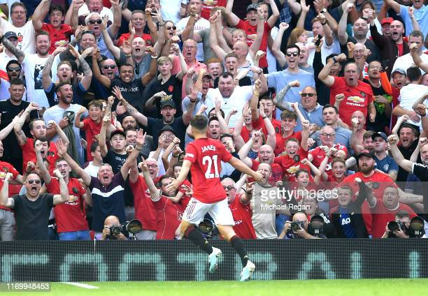 Daniel James of Manchester United celebrates scoring his team's first goal with fans during the Premier League match between Manchester United and...