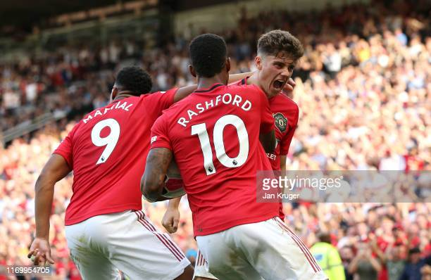 Daniel James of Manchester United celebrates scoring his team's first goal with Anthony Martial and Marcus Rashford during the Premier League match...