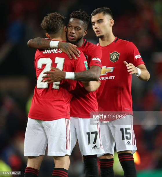 Daniel James of Manchester United celebrates scoring the winning penalty during the Carabao Cup Third Round match between Manchester United and...