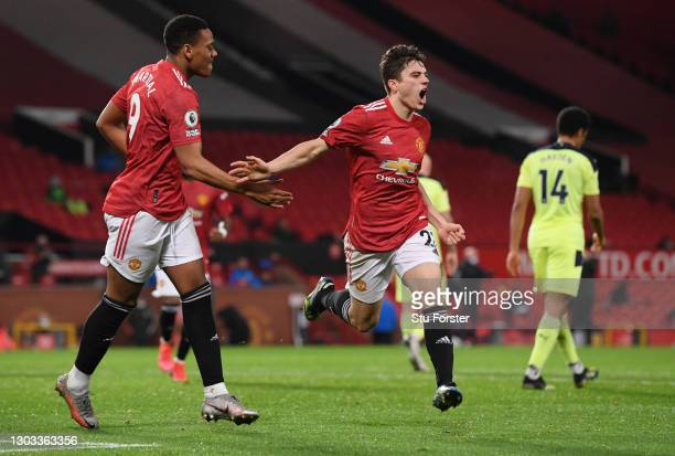 Daniel James of Manchester United celebrates with Anthony Martial after scoring his team's second goal during the Premier League match between...