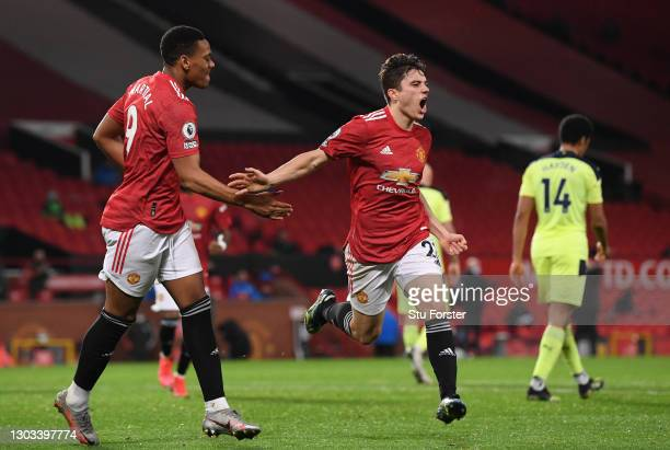 Daniel James of Manchester United celebrates with Anthony Martial after scoring the second goal during the Premier League match between Manchester...