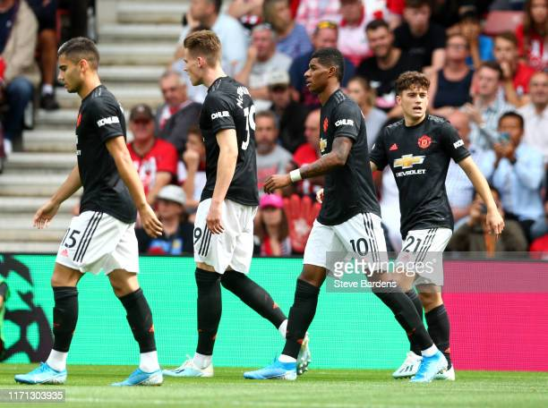 Daniel James of Manchester United celebrates with team mates after scoring his teams first goal during the Premier League match between Southampton...