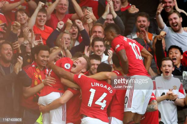 Daniel James of Manchester United celebrates with teammates after scoring his team's fourth goal during the Premier League match between Manchester...