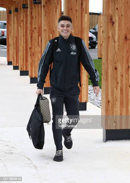 Daniel James of Manchester United checks in ahead of their flight to Linz at Manchester Airport on March 11 2020 in Manchester England
