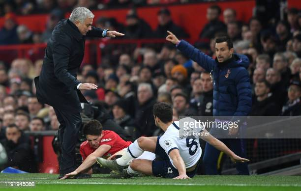 Daniel James of Manchester United collides into Jose Mourinho Manager of Tottenham Hotspur as he is tackled by Harry Winks of Tottenham Hotspur...
