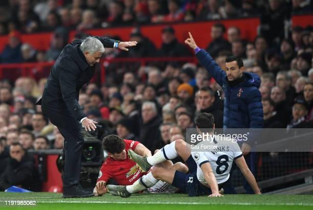 Daniel James of Manchester United collides into Jose Mourinho Manager of Tottenham Hotspur as he is tackled by Harry Winks of Tottenham Hotspur...