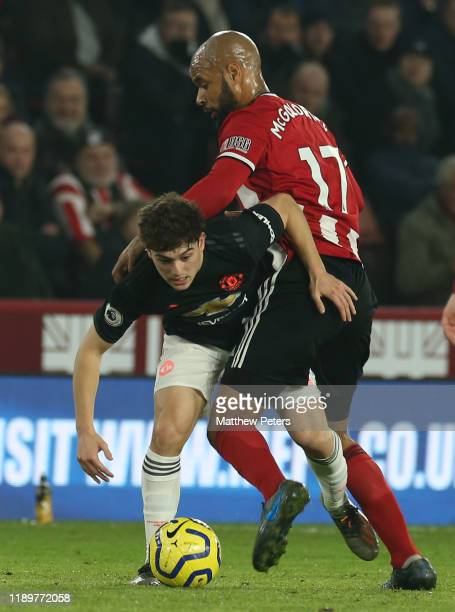 Daniel James of Manchester United in action with David McGoldrick of Sheffield United during the Premier League match between Sheffield United and...