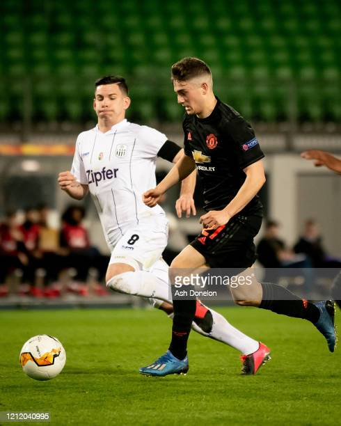 Daniel James of Manchester United in action with Peter Michorl of LASK during the UEFA Europa League round of 16 first leg match between LASK and...