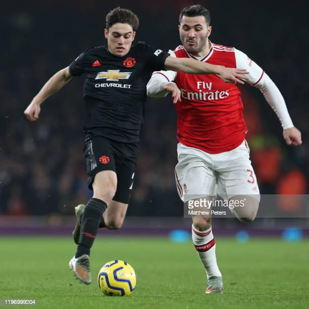 Daniel James of Manchester United in action with Sead Kolasinac of Arsenal during the Premier League match between Arsenal FC and Manchester United...