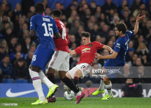 Daniel James of Manchester United is challenged by Marcos Alonso of Chelsea during the Carabao Cup Round of 16 match between Chelsea and Manchester...