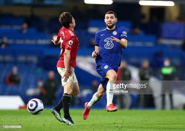 Daniel James of Manchester United is challenged by Mateo Kovacic of Chelsea during the Premier League match between Chelsea and Manchester United at...