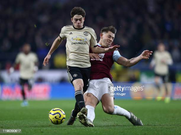Daniel James of Manchester United is tackled by James Tarkowski of Burnley FC during the Premier League match between Burnley FC and Manchester...