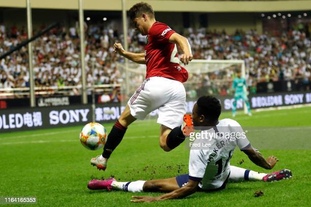 Daniel James of Manchester United is tackled by Kyle WalkerPeters of Tottenham Hotspur during the International Champions Cup match between Tottenham...