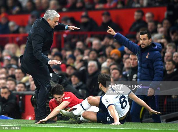 Daniel James of Manchester United knocks into Jose Mourinho Manager of Tottenham Hotspur as he is tackled by Harry Winks of Tottenham Hotspur during...