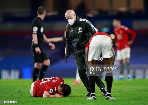 Daniel James of Manchester United receives medical treatment during the Premier League match between Chelsea and Manchester United at Stamford Bridge...