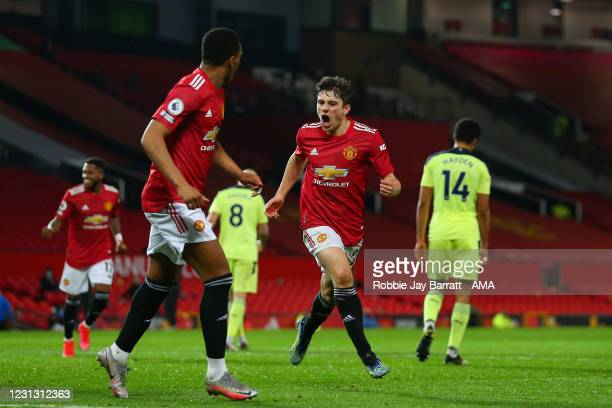 Daniel James of Manchester United scores a goal to make it 2-1 during the Premier League match between Manchester United and Newcastle United at Old...