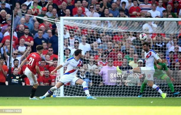 Daniel James of Manchester United scores his team's first goal during the Premier League match between Manchester United and Crystal Palace at Old...