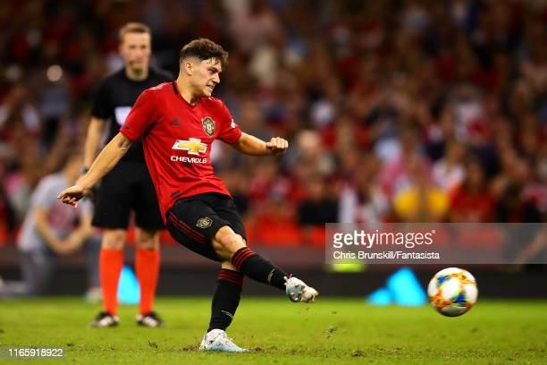 Daniel James of Manchester United scores the winning kick during the penalty shootout following the 2019 International Champions Cup match between...