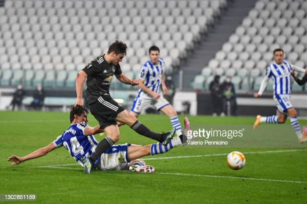 Daniel James of Manchester United scores their sides fourth goal under pressure from Robin Le Normand of Real Sociedad during the UEFA Europa League...