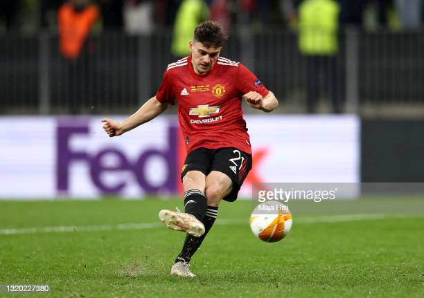 Daniel James of Manchester United scores their team's seventh penalty in the penalty shoot out during the UEFA Europa League Final between Villarreal...