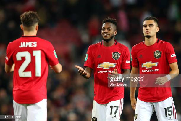 Daniel James of Manchester United took and scored the winning penalty in the shoot out celebrates with Fred and Andreas Pereira during the Carabao...