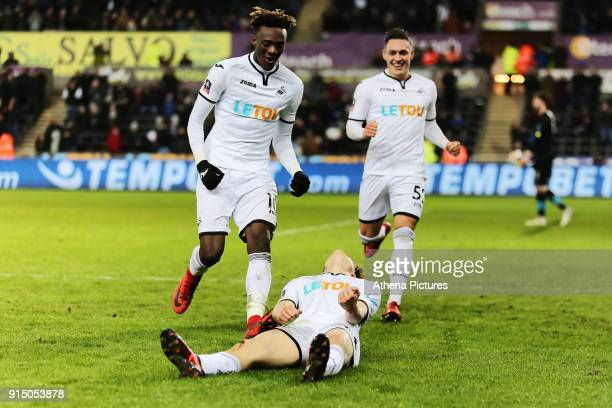Daniel James of Swansea celebrates his goal with team mates Tammy Abraham and Connor Roberts during The Emirates FA Cup match between Swansea City...