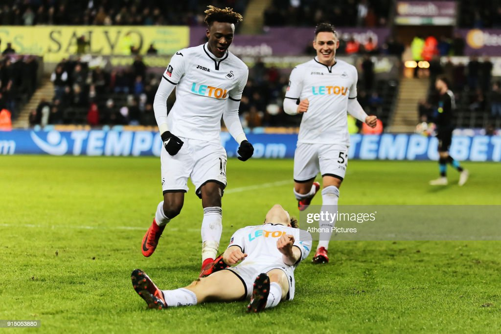 Daniel James of Swansea (C) celebrates his goal with team mates Tammy Abraham (L) and Connor Roberts (R) during The Emirates FA Cup match between Swansea City and Notts County at The Liberty Stadium on February 06, 2018 in Swansea, Wales.