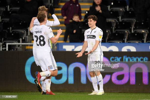Daniel James of Swansea City celebrates with teammates after scoring his team's third goal during the Sky Bet Championship between Swansea City and...