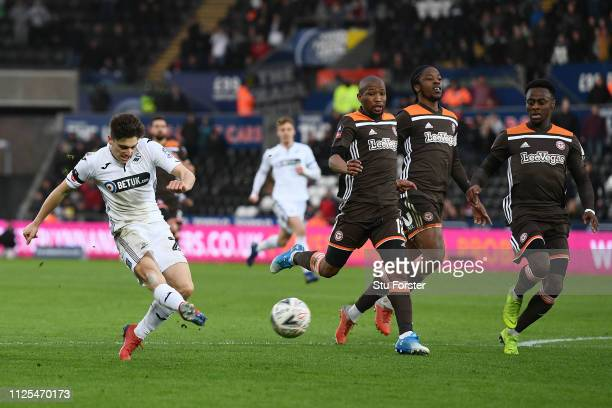 Daniel James of Swansea City scores his team's second goal during the FA Cup Fifth Round match between Swansea and Brentford at Liberty Stadium on...