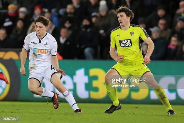 Daniel James of Swansea marked by Matty Virtue of Notts County during The Emirates FA Cup match between Swansea City and Notts County at The Liberty...