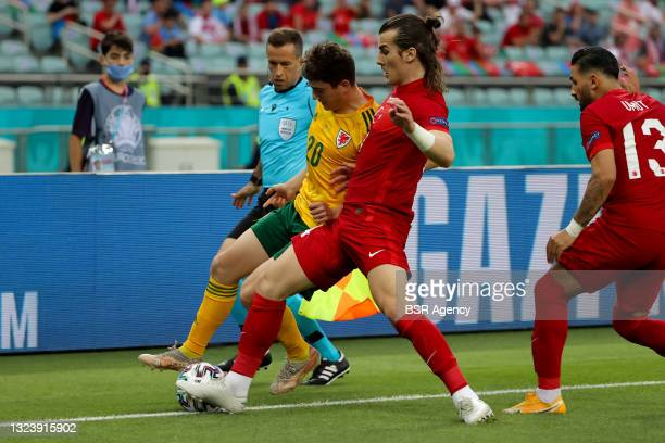 Daniel James of Wales and Caglar Soyuncu of Turkey battle for possession during the UEFA Euro 2020 Championship Group A match between Turkey National...