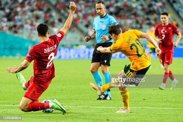 Daniel James of Wales attempts a kick while being defended by Mehmet Zeki Celik of Turkey during the UEFA Euro 2020 Championship Group A match...