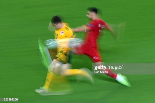 Daniel James of Wales battles for possession with Cengiz Under of Turkey during the UEFA Euro 2020 Championship Group A match between Turkey and...