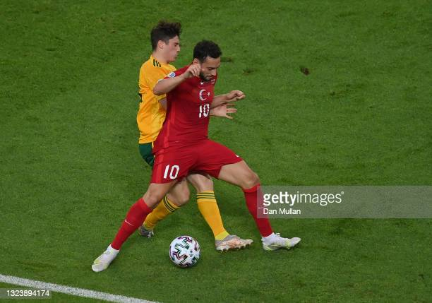Daniel James of Wales battles for possession with Hakan Calhanoglu of Turkey during the UEFA Euro 2020 Championship Group A match between Turkey and...