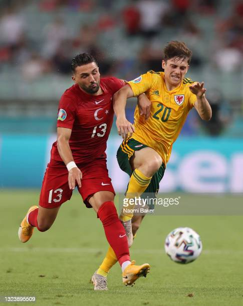 Daniel James of Wales battles for possession with Umut Meras of Turkey during the UEFA Euro 2020 Championship Group A match between Turkey and Wales...