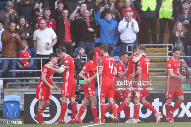 Daniel James of Wales celebrates after scoring a goal to make it 10 with Gareth Bale during the 2020 UEFA European Championships group E qualifying...