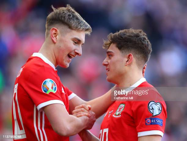 Daniel James of Wales celebrates after scoring his team's first goal with David Brooks during the 2020 UEFA European Championships group E qualifying...