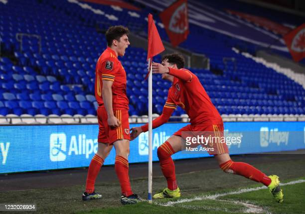 Daniel James of Wales celebrates scoring the opening goal with Neco Williams during the FIFA World Cup 2022 Qatar qualifying match between Wales and...