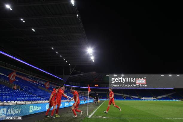 Daniel James of Wales celebrates scoring the opening goal with Neco Williams, James Lawrence and Joe Morrell at an empty Cardiff City Stadium during...