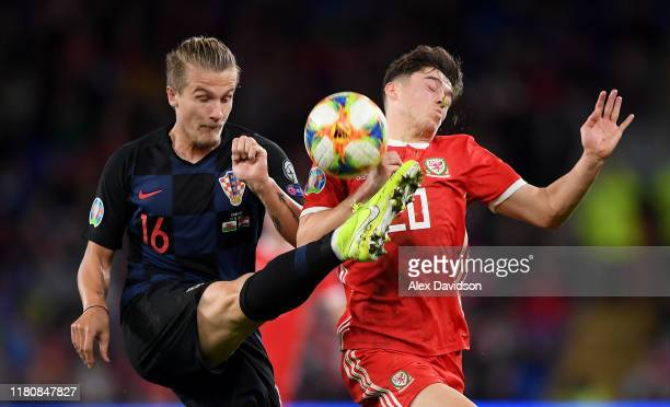 Daniel James of Wales is beaten to the ball by Tin Jedvaj of Croatia during the UEFA Euro 2020 qualifier between Wales and Croatia at Cardiff City...